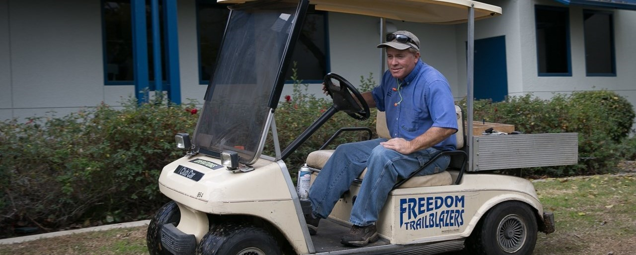 Freedom Elementary plant supervisor in golf cart
